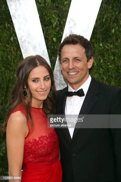 Actor Seth Meyers and Alexi Ashe arrive at the Vanity Fair Oscar Party at Sunset Tower in West Hollywood Los Angeles USA on 24 February 2013 Photo...