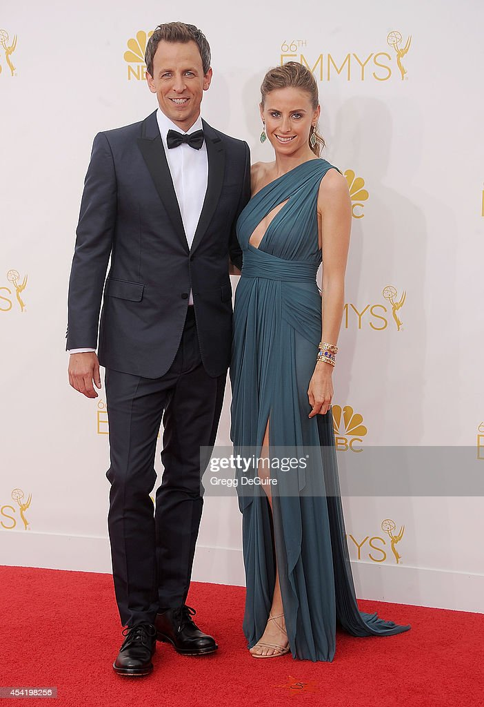 Actor Seth Meyers and wife Alexi Ashe arrive at the 66th Annual Primetime Emmy Awards at Nokia Theatre L.A. Live on August 25, 2014 in Los Angeles, California.