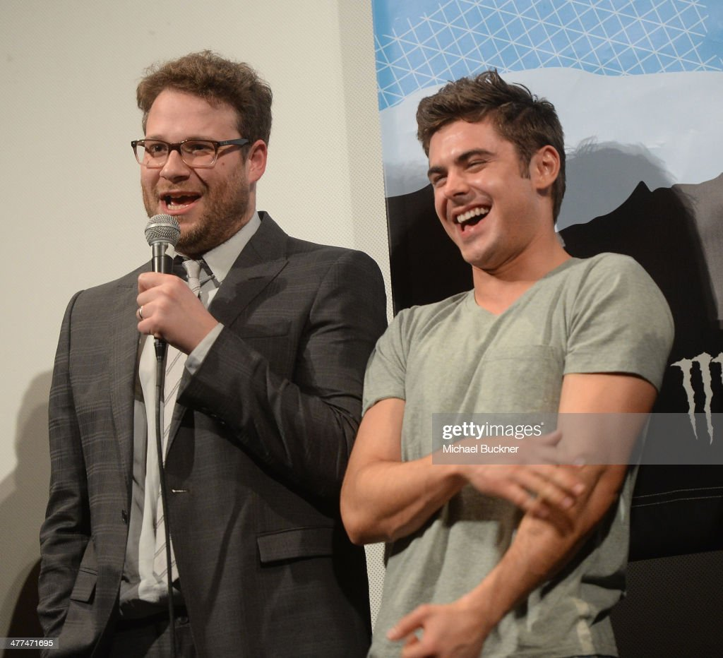 Actor Seth Rogen (L) and actor Zac Efron speak on stage at the premiere of 'Neighbors' during the 2014 SXSW Music, Film + Interactive Festival at the Paramount Theatre on March 8, 2014 in Austin, Texas.