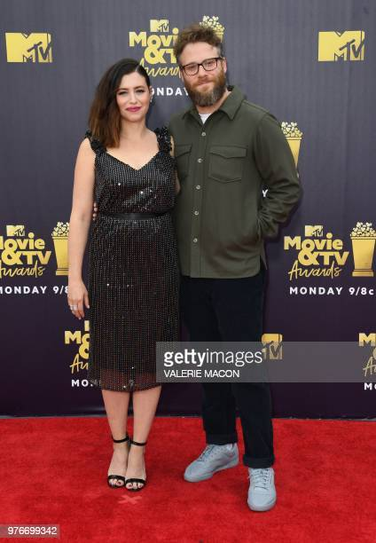 US actor Seth Rogen and his wife US actress and writer Lauren Miller attend the 2018 MTV Movie TV awards at the Barker Hangar in Santa Monica on June...