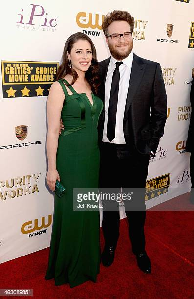 Actor Seth Rogen and Lauren Miller attend the 19th Annual Critics' Choice Movie Awards at Barker Hangar on January 16 2014 in Santa Monica California