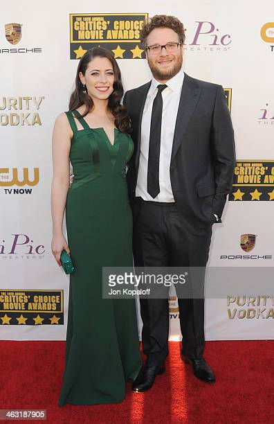 Actor Seth Rogen and wife Lauren Miller arrive at the 19th Annual Critics' Choice Movie Awards at Barker Hangar on January 16 2014 in Santa Monica...
