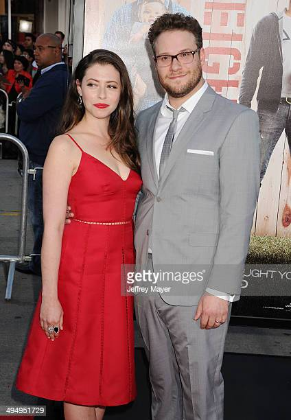 Actor Seth Rogen and wife Lauren Miller arrive at the Los Angeles premiere of 'Neighbors' at Regency Village Theatre on April 28 2014 in Westwood...