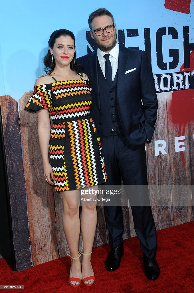 Actor Seth Rogen and wife Lauren Miller arrive for the Premiere Of Universal Pictures' 'Neighbors 2: Sorority Rising' held at Regency Village Theatre on May 16, 2016 in Westwood, California.