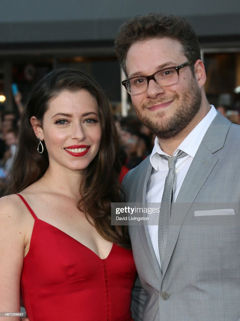Actor Seth Rogen (R) and wife Lauren Miller attend the premiere of Universal Pictures' 'Neighbors' at Regency Village Theatre on April 28, 2014 in Westwood, California.