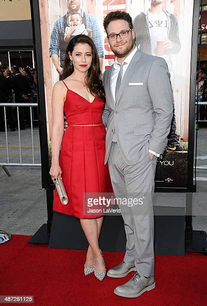 Actor Seth Rogen and wife Lauren Miller attend the premiere of 'Neighbors' at Regency Village Theatre on April 28 2014 in Westwood California