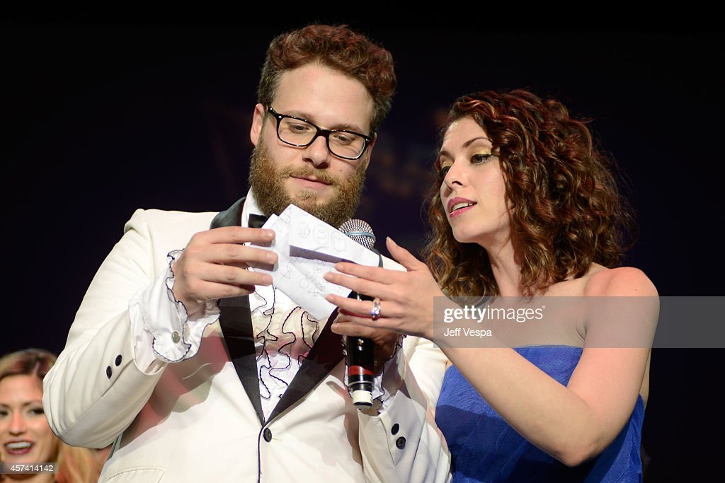 Actor Seth Rogen (L) and wife Lauren Miller on stage at the 3rd Annual Hilarity for Charity Variety Show to benefit the Alzheimer's Association, presented by Genworth, at Hollywood Palladium on October 17, 2014 in Hollywood, California.