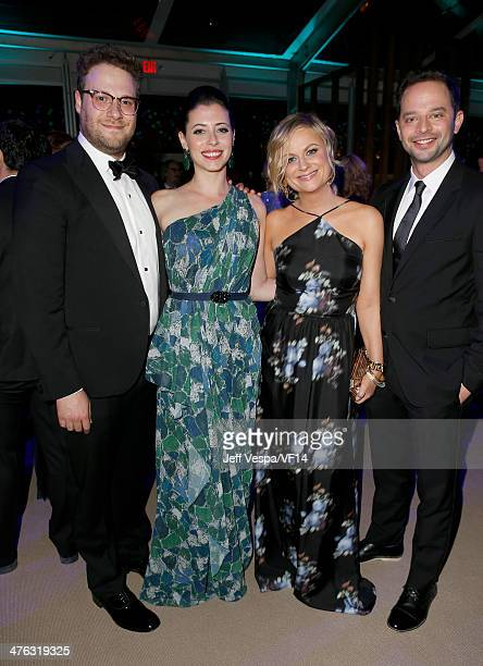 Actor Seth Rogen Lauren Miller actor Amy Poehler and actor Nick Kroll attend the 2014 Vanity Fair Oscar Party Hosted By Graydon Carter on March 2...