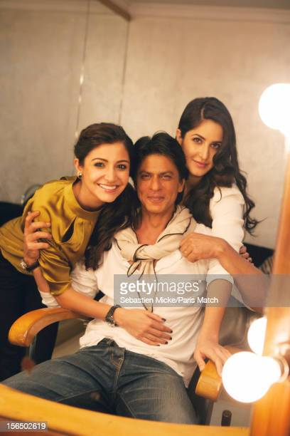 Actor Shah Rukh Khan is photographed with actors Anushka Sharma and Katrina Kaif during the press conference for the film 'Jab Tak Hai Jaan' for...