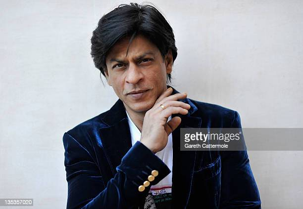 Actor Shah Rukh Khan poses during a portrait session at the 8th Annual Dubai International Film Festival held at the Madinat Jumeriah Complex on...