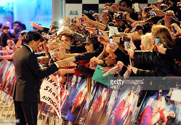 Actor Shah Rukh Khan signs autographs as he arrives for the UK premiere of Ra One at the O2 Arena on October 25 2011 AFP PHOTO / FACUNDO ARRIZABALAGA
