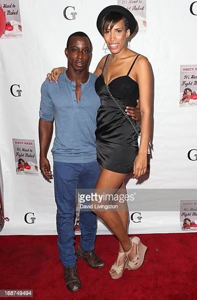 Actor Shaka Smith and model Hazel Estrella attend a Niecy Nash signing for her book It's Hard to Fight Naked at the Luxe Rodeo Drive Hotel on May 14...
