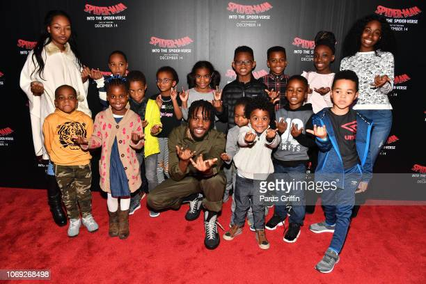 Actor Shameik Moore poses with young moviegoers during the 'Spiderman Into The SpiderVerse' Atlanta screening at Regal Atlantic Station on December 6...