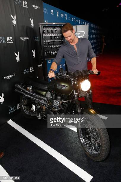 Actor Shane West wins a donation to the charity of his choice after successfully starting the Triumph Scrambler Custom on display at the Playboy and...