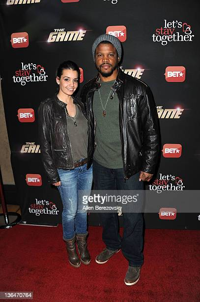 Actor Sharif Atkins and Bethany Hotchkiss arrive at the BET's The Game And Let's Stay Together series premiere at Hollywood Roosevelt Hotel on...