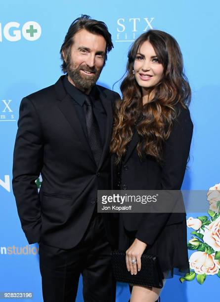 Actor Sharlto Copley and model Tanit Phoenix attend the world premiere of 'Gringo' from Amazon Studios and STX Films at Regal LA Live Stadium 14 on...