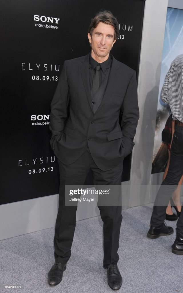Actor Sharlto Copley arrives at the Los Angeles premiere of 'Elysium' at Regency Village Theatre on August 7, 2013 in Westwood, California.