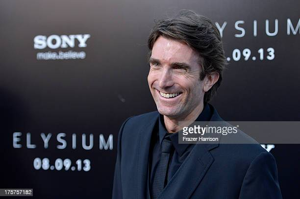Actor Sharlto Copley arrives at the premiere of TriStar Pictures' Elysium at Regency Village Theatre on August 7 2013 in Westwood California