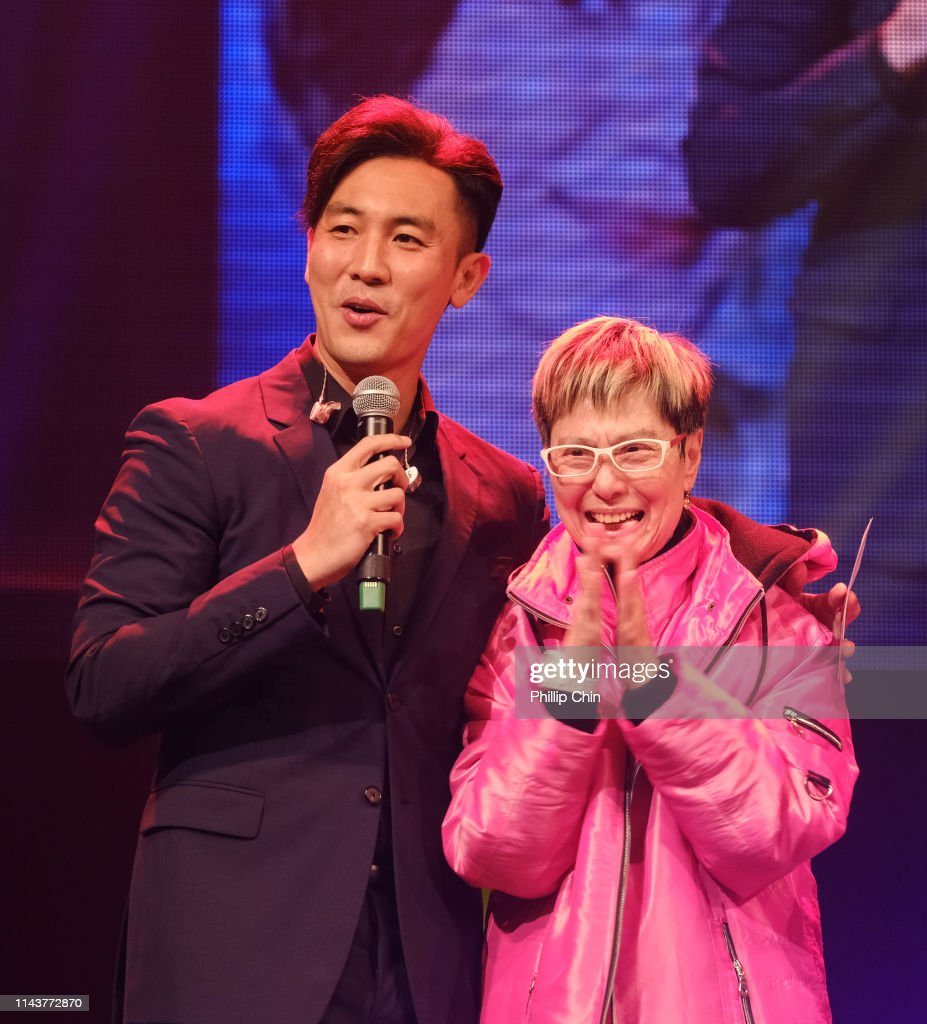 Actor Shaun Tam and singer Sandra Lang onstage during the