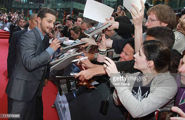 Actor Shia LaBeouf sign autographs as he attends the 'Transformers 3' European premiere on June 25 2011 in Berlin Germany