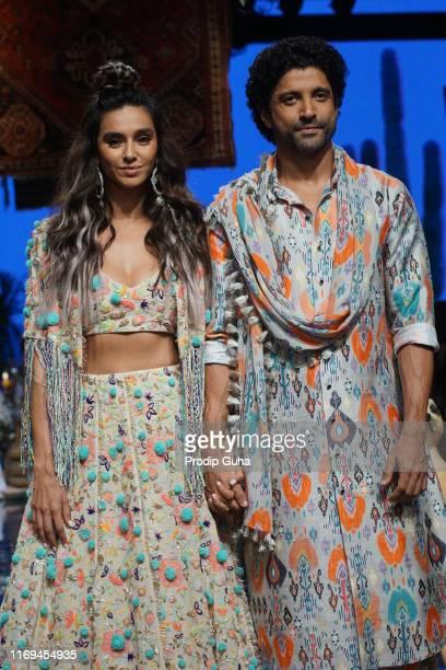 Actor Shibani Dandekar and farhan aktar walk the ramp for designer Payel Singhal creation in Lakme fashion week winter collection 2019 on August...