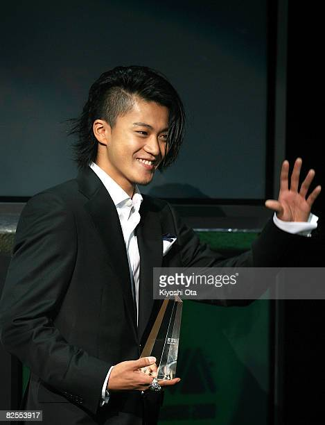 Actor Shun Oguri waves to fans after receiving the Best 'Student Voice' Actor award during the MTV Student Voice Awards 2008 at Shinkiba Studio Coast...