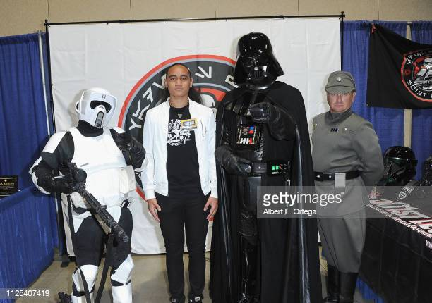 Actor Siaki Sii poses with Darth Vader a Speeder Trooper and Imperial Officer at the 2019 Long Beach Comic Expo held at Long Beach Convention Center...