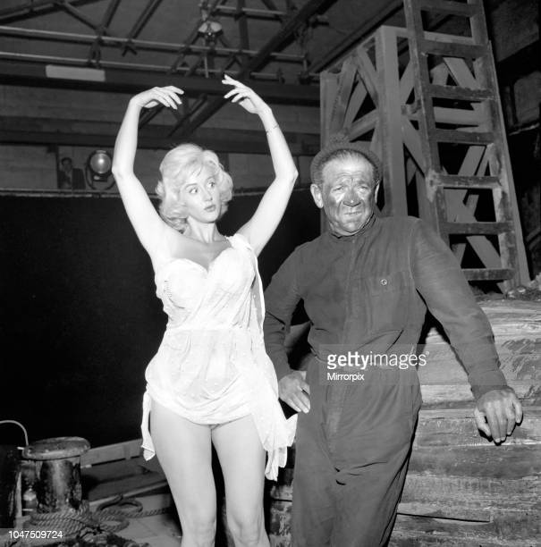 Actor Sidney James on set with Liz Fraser at Twickenham Studios were they are making 'Double Bunk' October 1960