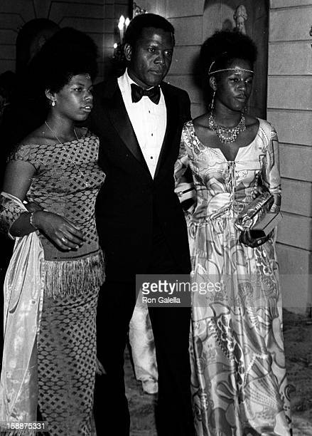 Actor Sidney Poitier and daughters attending Andrew Young For Congress Support Committee Dinner Dance on June 10 1970 at the Pierre Hotel in New York...