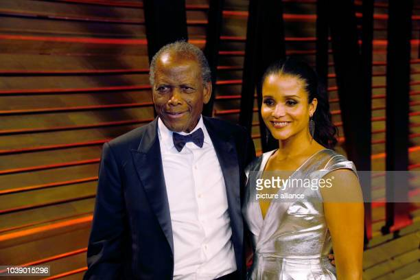 Actor Sidney Poitier and his daughter, actress Sydney Tamiia Poitier, arrive at the Vanity Fair Oscar Party in West Hollywood, Los Angeles, USA, 02...