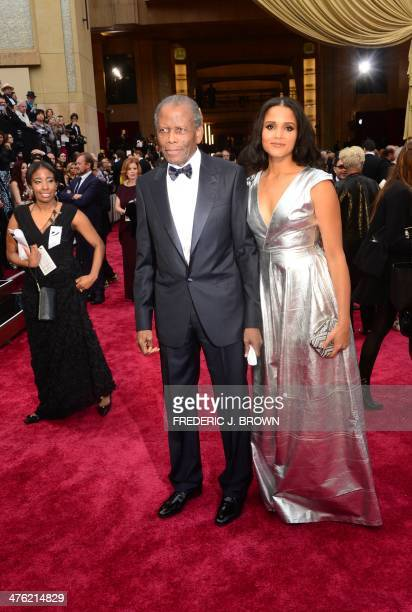 Actor Sidney Poitier arrives with daughter Sydney Tamiia Poitier on the red carpet for the 86th Academy Awards on March 2nd, 2014 in Hollywood,...