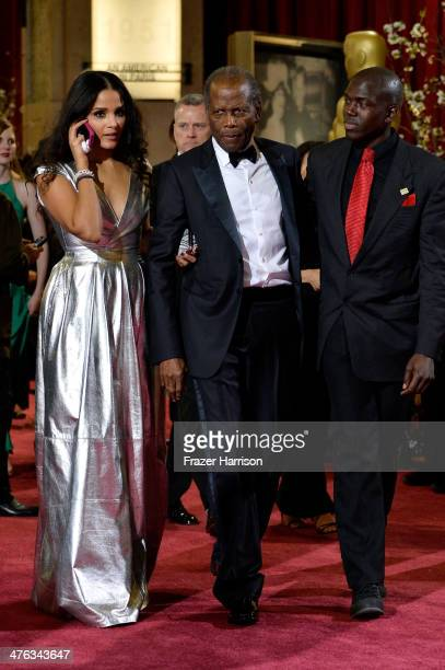 Actor Sidney Poitier daughter Sydney Tamiia Poitier and guest depart the Oscars at Hollywood Highland Center on March 2 2014 in Hollywood California
