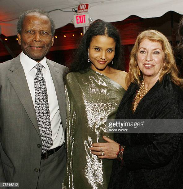 Actor Sidney Poitier, his daughter, actress Sydney Tamiia Poitier and his wife Joanna Shimkus pose at the afterparty for the premiere at Dimension...
