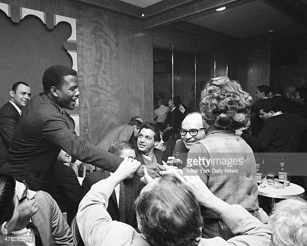 Actor Sidney Poitier on hand as observer shakes hands with his admirers at Peppermint Lounge a West Side spot that was just another bar until...