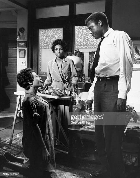 Actor Sidney Poitier with actresses Claudia McNeil and Ruby Dee in the 1961 film version of 'A Raisin in the Sun' Undated movie Still