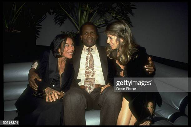 Actor Sidney Poitier with wife Joanna Shimkus and Julie Belafonte wife of entertainer Harry Belafonte