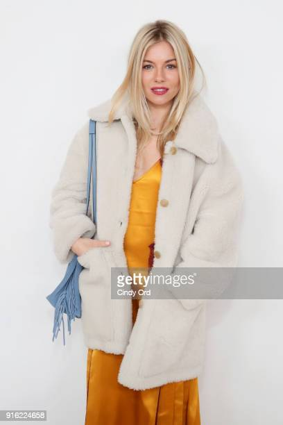 Actor Sienna Miller attends the Tory Burch Fall Winter 2018 Fashion Show during New York Fashion Week at Bridge Market on February 9, 2018 in New...