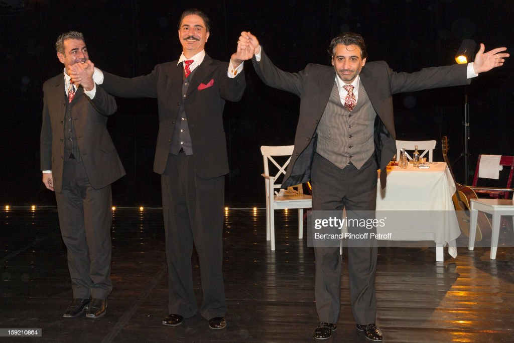 Actor Simon Abkarian (C), musicians Gregoris Vassila (R) and Kostas Tsekouras acknowledge applause after performing on stage during the premiere of 'Menelas rebetiko rapsodie', that Abkarian wrote and directed, at Le Grand Parquet on January 9, 2013 in Paris, France.