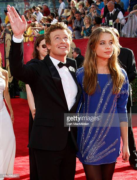 Actor Simon Baker and guest arrives at the 61st Primetime Emmy Awards held at the Nokia Theatre on September 20 2009 in Los Angeles California