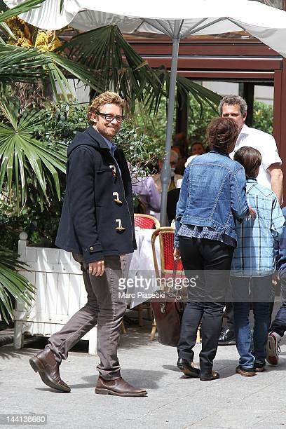 Actor Simon Baker and wife Rebecca Rigg arrive at the 'La Cigale Recamier' restaurant on May 10 2012 in Paris France