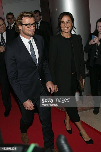 Actor Simon Baker and wife Rebecca Riggs arrive to attend the 'MENTALIST' photocall at TF1 TV studios on February 6 2015 in Paris France
