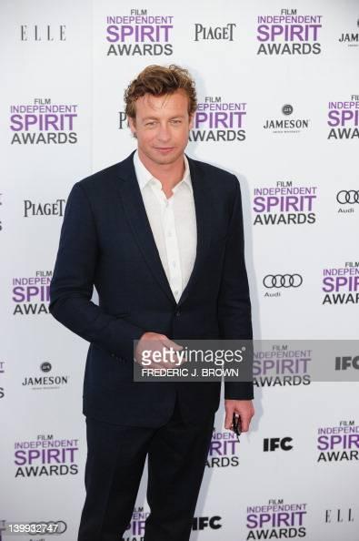 Actor Simon Baker arrives on the red carpet on February 25