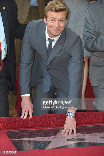 Actor Simon Baker attends a ceremony honoring him with the 2490th Star on The Hollywood Walk of Fame on February 14 2013 in Hollywood California