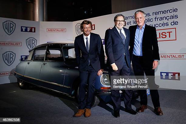 Actor Simon Baker Nonce Paolini President of TF1 and Screenwriter Bruno Heller attend the 'MENTALIST' photocall at TF1 TV studios on February 6 2015...