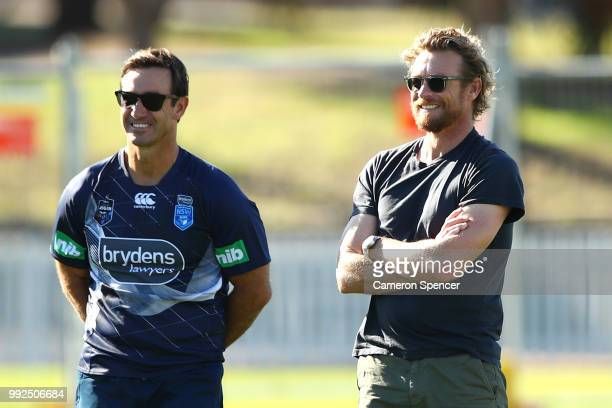 Actor Simon Baker talks to Blues assistant coach Andrew Johns during a New South Wales Blues State of Origin training session at Coogee Oval on July...