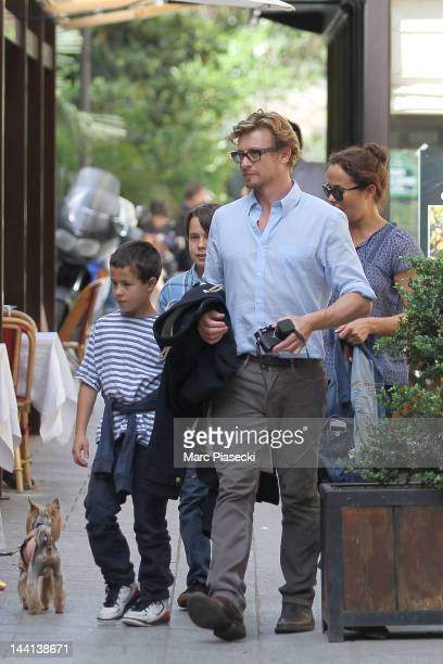Actor Simon Baker wife Rebecca Rigg and their chidren leave the 'La Cigale Recamier' restaurant on May 10 2012 in Paris France