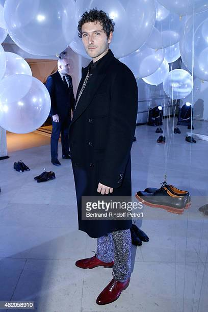 Actor Simon Buret attends the Berluti Menswear Fall/Winter 20152016 Show as part of Paris Fashion Week Held at Musee des Arts Decoratifs on January...