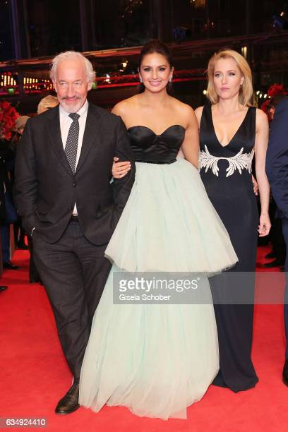 Actor Simon Callowactress Huma Qureshi and actress Gillian Anderson attend the 'Viceroy's House' premiere during the 67th Berlinale International...