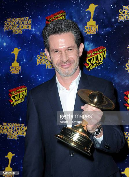 Actor Simon Kinberg poses in the pressroom at the 42nd annual Saturn Awards at The Castaway on June 22 2016 in Burbank California