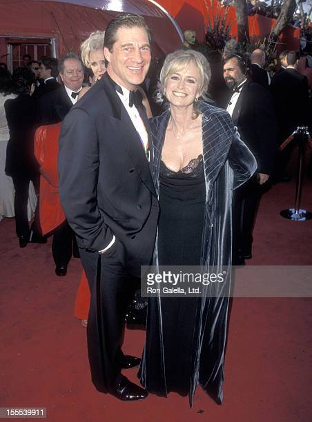 Actor Simon MacCorkindale and actress Susan George attend the 71st Annual Academy Awards on March 21 1999 at Dorothy Chandler Pavilion in Los Angeles...